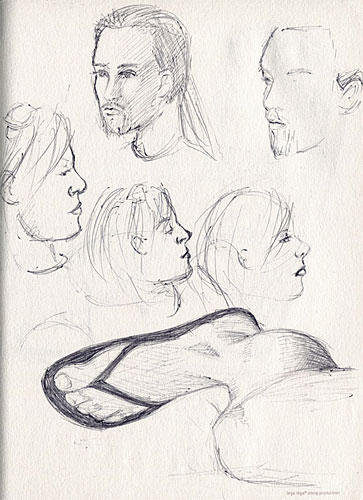 portrait sketches and a foot sketch in ballpoint pen